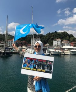 Dilnur Kroren with East Turkistan Flag